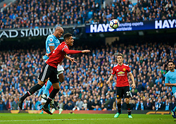 MANCHESTER, ENGLAND - Saturday, April 7, 2018: Manchester City's captain Vincent Kompany scores the first goal with a header during the FA Premier League match between Manchester City FC and Manchester United FC at the City of Manchester Stadium. (Pic by David Rawcliffe/Propaganda)