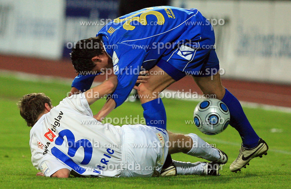 Sasa Bakaric and Andraz Kirm at 30th Round of Slovenian First League football match between NK Domzale and NK MIK CM Celje in Sports park Domzale, on April 25, 2009, in Domzale, Slovenia. Celje won 3:0. (Photo by Vid Ponikvar / Sportida)