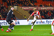 Mallik Wilks of Doncaster Rovers (7) shoots as Liam Lindsay of Barnsley (6) blocks during the EFL Sky Bet League 1 match between Doncaster Rovers and Barnsley at the Keepmoat Stadium, Doncaster, England on 15 March 2019.