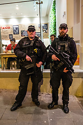 Heavily armed policemen on duty at Edinburgh Hogmanay street party on New Year's Eve in Scotland , United Kingdom