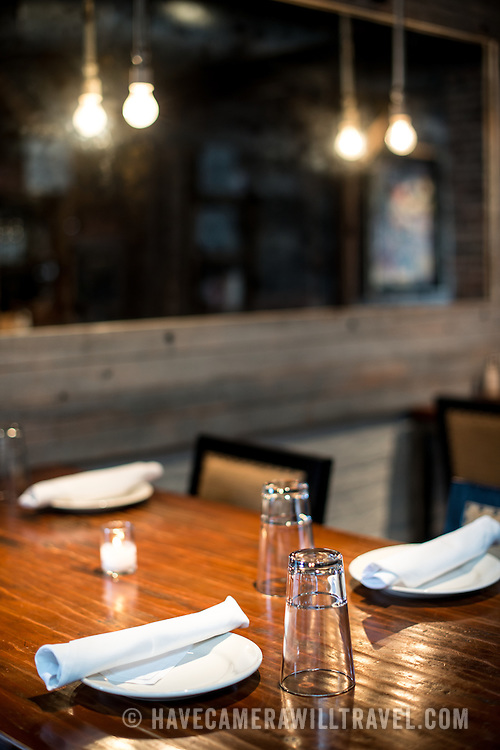 A restaurant table setting in a restored historic grain warehouse.