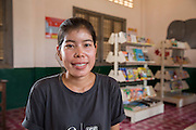 ICS volunteer Sokuntheary Nhel in the library of the local school in the village of Banteay Char, near Battambang, Cambodia.