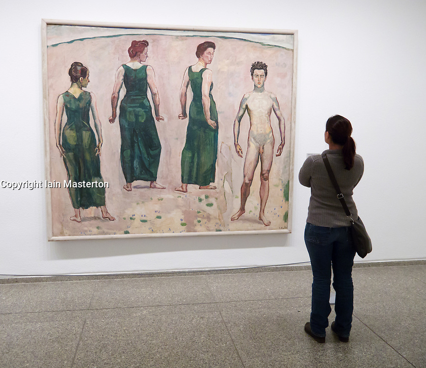 woman looking at painting Young Man Admired by Woman by Ferdinand Hodler  in Neue Nationalgalerie in Kulturforum in Berlin Germany
