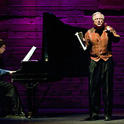 January 14, 2012 - Brooklyn, NY : .From left, pianist Michael Brofman and tenor Paul Sperry perform the work of Charles Ives at the Galapagos Art Space in DUMBO, Brooklyn, on Saturday evening..CREDIT: Karsten Moran for The New York Times