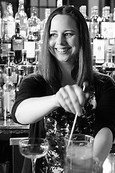 Cheryl Gibbs stirs a cocktail at Bad News Bar. (Editorial)