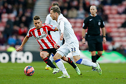 Casper Sloth of Leeds United is challenged by Emanuele Giaccherini of Sunderland - Photo mandatory by-line: Rogan Thomson/JMP - 07966 386802 - 04/01/2015 - SPORT - FOOTBALL - Sunderland, England - Stadium of Light - Sunderland v Leeds United - FA Cup Third Round Proper.