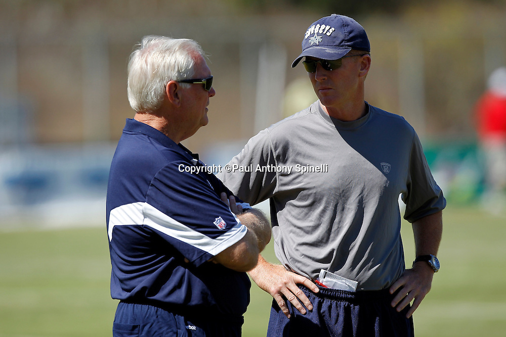 Dallas Cowboys Head Coach Wade Phillips (left) speaks to Cowboys Offensive Coordinator Jason Garrett during NFL football training camp on Wednesday, August 18, 2010 in Oxnard, California. (©Paul Anthony Spinelli)