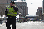 A Boston police officer shouts instructions on Boylston Street in Boston on April 15, 2013. Three people were killed by two explosions on Boylston Street near the finish line of the Boston Marathon, in which 27,000 people competed.
