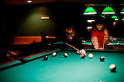 17315Members of The Underground dance group the Sibs Weekend Variety Show 2/06: Photos by Michael Rubenstein..Braden Green, 11, from Lancaster plays pool with his brother David during Sibs Weekend on Friday, February 3, 2006.