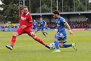 Andy Barcham midfielder for AFC Wimbledon (17) and Nicky Hunt defender for Leyton Orient (34) battle during the Sky Bet League 2 match between AFC Wimbledon and Leyton Orient at the Cherry Red Records Stadium, Kingston, England on 23 April 2016. Photo by Stuart Butcher.