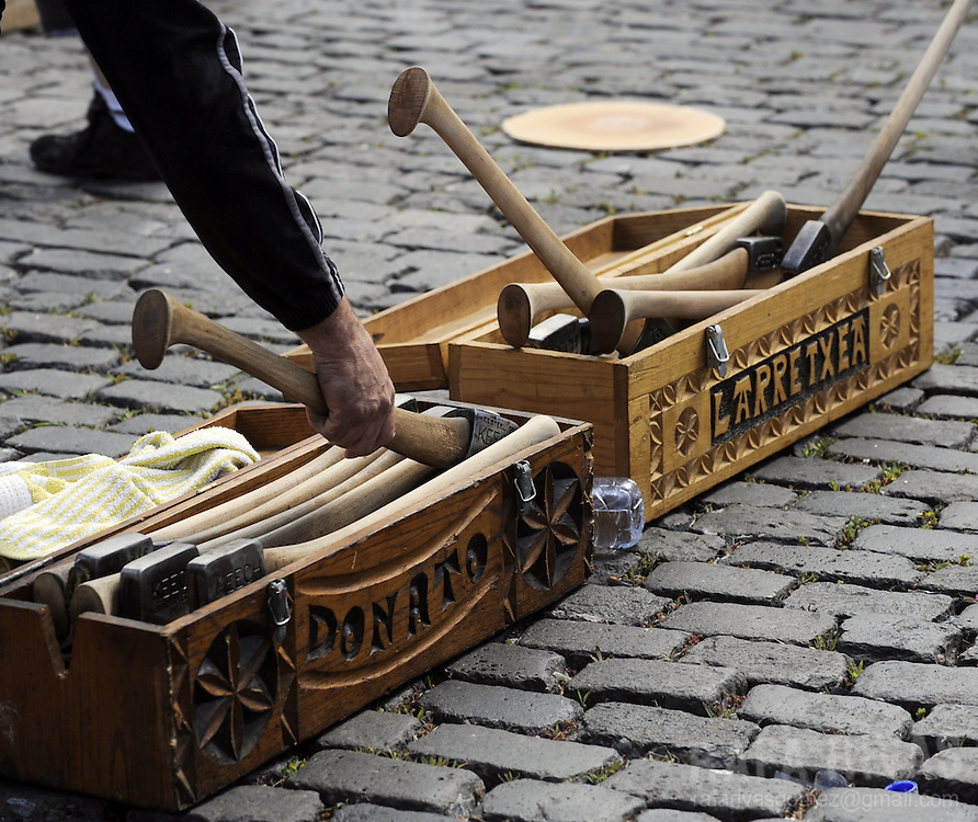 An aizkolari (woodchopper in Basque) grabs an axe during a rural Basque sports championship, on July 8, 2012, during San Fermin Festival, in the Northern Spanish city of Pamplona. PHOTO / Rafa Rivas