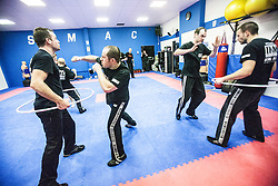 Students attacking the area of the hoop, Stef Noij, KMG Instructor from the Institute Krav Maga Netherlands, at the IKMS G Level Programme seminar today at the Scottish Martial Arts Centre, Alloa.