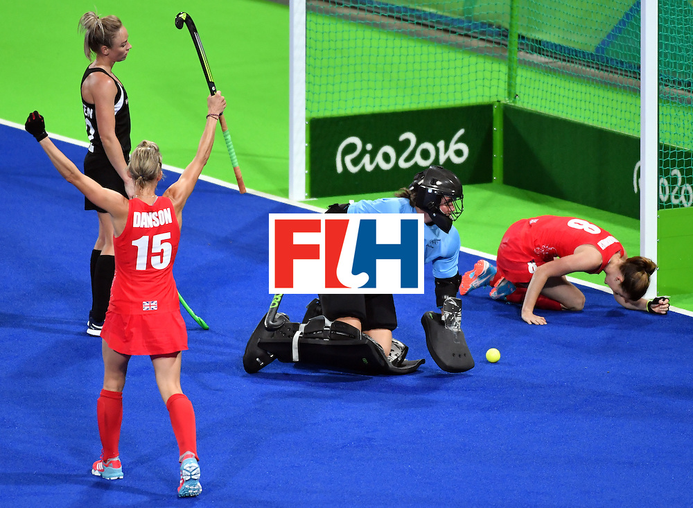 Britain's Alex Danson (L) celebrates her teammate Britain's Helen Richardson-Walsh's goal during the women's semifinal field hockey New Zealand vs Britain match of the Rio 2016 Olympics Games at the Olympic Hockey Centre in Rio de Janeiro on August 17, 2016. / AFP / Pascal GUYOT        (Photo credit should read PASCAL GUYOT/AFP/Getty Images)