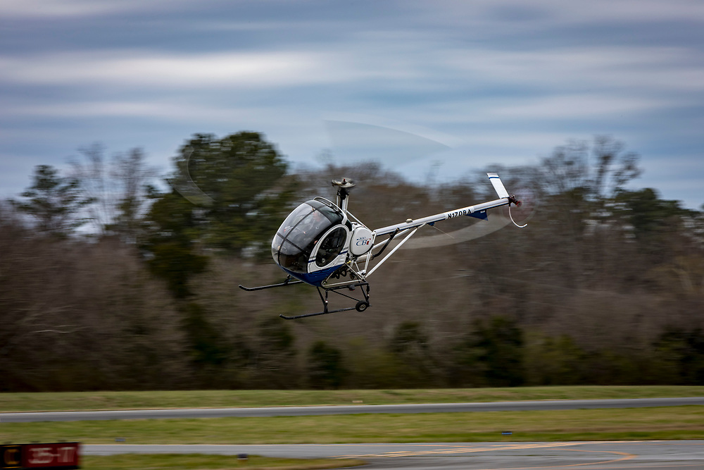 A 2004 SCHWEIZER 269C-1 Rotorcraft <br /> practicing maneuvers at Tom B. David Airport in Calhoun, Georgia.<br /> <br /> Created by aviation photographer John Slemp of Aerographs Aviation Photography. Clients include Goodyear Aviation Tires, Phillips 66 Aviation Fuels, Smithsonian Air & Space magazine, and The Lindbergh Foundation.  Specialising in high end commercial aviation photography and the supply of aviation stock photography for advertising, corporate, and editorial use.