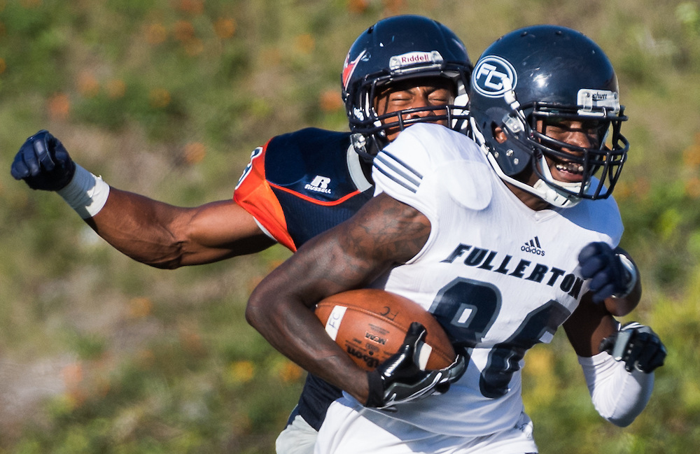 November 5, 2016 - Santa Ana, CA - Fullerton College Freshman WR Markel Atkins (88) tackled by Orange Coast College Freshman LB Michael Archer (49) in their win 35-14