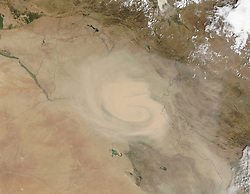 Dust and sand storms in the Middle East and other arid regions tend to come in two forms. Haboobs are dramatic events associated with storm fronts and often appear as walls of sand and dust marching across the landscape. But like thunderstorms, haboobs tend to abrupt and short-lived. Then there are the long-lived, wide-reaching dust storms that can last for days. In Iraq, such storms are often associated with the shamal, a pattern of persistent northwesterly winds.<br /> In early September 2015, a storm with characteristics of both the shamal and the haboob moved across Iraq, Iran, and the Persian Gulf region. The Moderate Resolution Imaging Spectroradiometer (MODIS) on NASA's Terra satellite captured these natural-color images of the dust storm on September 1 and September 3, 2015.<br /> The dust event first appeared in NASA satellite imagery along the Iraq–Syria border on August 31. By the next day, the storm took on the cyclonic shape visible in the top image above. By September 2, the dust cloud reached the Persian Gulf. It had spread out across the entire basin by the time of the September 3 image above.<br /> The storm appears to have been triggered by a surface low-pressure system that moved from northwest to southeast during the week. The cyclonic circulation around the center of low pressure is most obvious in the September 1 image. Weather data from ground stations in Baghdad, Khormor, and Al Asad confirm the wind circulation pattern. But the overall movement of the system from the northwest toward the Persian Gulf also suggests late-summer shamal winds.<br /> Much of northern Iraq has been in a state of exceptional drought. Anecdotal evidence and media reports in recent years suggest that dust storms have become more common in Iraq and Iran, a result of that drought and of the human and natural destruction of wetlands in the Tigris-Euphrates watersheds.<br /> News reports and social media chatter in September 2015 described wind gusts up to 80 kilometers (50 miles) per hour in Iran