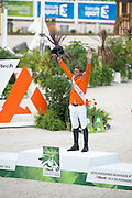 Jeroen Dubbeldam and Zenith SFN World Champion Individual Jumping<br /> Alltech FEI World Equestrian Games™ 2014 - Normandy, France.<br /> © DigiShots - Jon Stroud