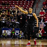 09 March 2018: San Diego State men's basketball takes on Nevada in the quarterfinal round of the Mountain West Conference Tournament. San Diego State Aztecs guard Trey Kell (3) gives props to his teammate Devin Watson after making a three point shot early in the fist half against Nevada. The Aztecs cruise past the Wolfpack 90-73 to move on to the Championship game tomorrow afternoon at 3pm.<br /> More game action at www.sdsuaztecphotos.com