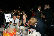 JONATHAN SAUNDERS; TIPHAINE DE LUSSY; SIR ELTON JOHN, Grey Goose Winter Ball to Benefit the Elton John AIDS Foundation. Battersea park. London. 29 October 2011. <br /> <br />  , -DO NOT ARCHIVE-© Copyright Photograph by Dafydd Jones. 248 Clapham Rd. London SW9 0PZ. Tel 0207 820 0771. www.dafjones.com.