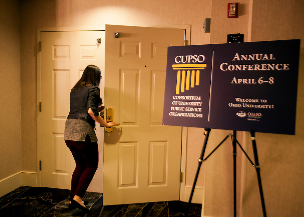 A participant enters the Cutler Ballroom for a plenary session at the Cutler Ballroom at the Ohio University Inn, Athens, OH, on Thursday, April 7, 2016 --The Voinovich School of Leadership and Public Affairs is hosting the CUPSO (Consortium of University Public Service Organizations) annual conference at Ohio University in Athens, OH, from April 6-8, 2016. © Ohio University / Sonja Y. Foster