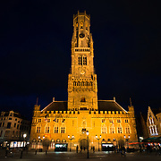 Night shot of the Belfry bell tower in the Markt (Market Square) in the historic center of Bruges, a UNESCO World Heritage site.