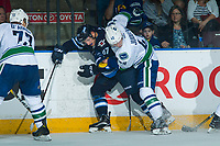 PENTICTON, CANADA - SEPTEMBER 8: Olli Juolevi #48 of Vancouver Canucks checks Cristiano DaGiacinto #87 of Winnipeg Jets into the boards during second period on September 8, 2017 at the South Okanagan Event Centre in Penticton, British Columbia, Canada.  (Photo by Marissa Baecker/Shoot the Breeze)  *** Local Caption ***