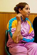 Roma 27 Dicembre 2013<br /> Il Centro di identificazione ed espulsione (CIE), per immigrati di Ponte Galeria a Roma.<br /> 'Romeo e Giulietta' al Cie di Ponte Galeria a Roma<br /> Al&igrave; e Alia  si sono innamorati e sposati a Tunisi contro il volere della famiglia di lei. I fratelli di Alia, estremisti salafiti, l&rsquo;avevano promessa in sposa a un altro  uomo che lei non conosceva,per questo rifiuto a subito la violenza e la segregazione in casa, fino alla fuga, e lo sbarco in Sicilia, ma poi sono finiti al CIE di Ponte Galeria con il rischio di essere espulsi e tornare i Tunisia dove rischiano la morte.Alia mostra la ferita inferta dai fratelli<br /> Rome December 27, 2013.<br /> The Center for Identification and Expulsion (CIE) for immigrants from Ponte Galeria in Rome.<br /> 'Romeo and Juliet' to the Cie of Bridge Galeria in Rome  <br /> Al&igrave; and Alia are him in love and gotten married to Tunisi against the will of her family. The brothers of Alia, extremists salafiti, had promised her in bride to another man that her not conosceva,per this refusal to immediately the violence and the segregation in the house, up to the escape and the unloading in Sicily, but then they are ended to the CIE of Bridge Galeria with the risk to be expelled and to return Tunisia where they risk the death.Alia shows the wound inflicted by the brothers