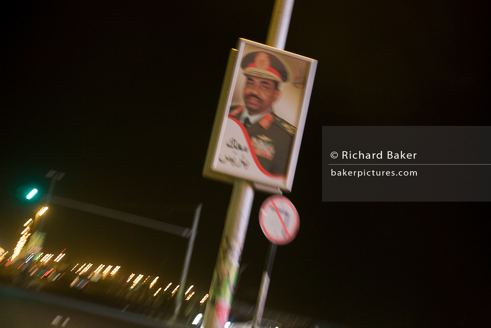 Dressed in army uniform is a portrait of the military Colonel Sudanese President, Omar Hassan Ahmad al-Bashir in the central reservation of a highway near Khartoum's international airport.
