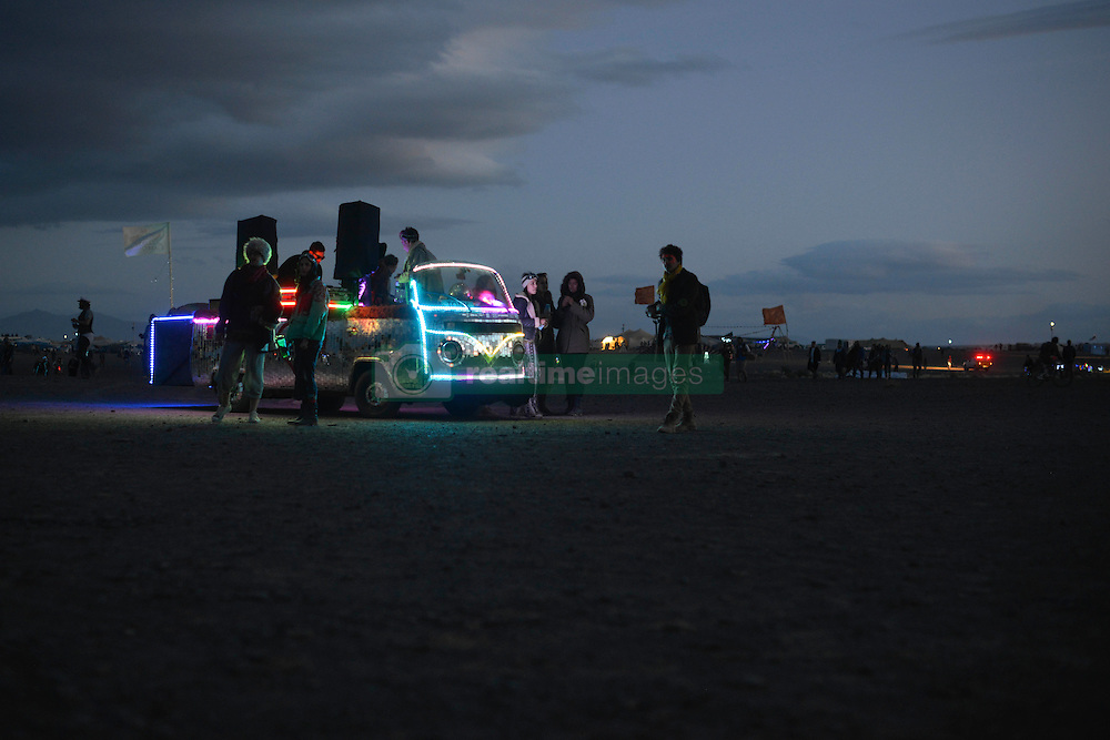 Apr 29, 2016 - Tankwa Town, Karoo Desert, South Africa - A modified vehicle adorned in LED lights, also known as a ''mutant vehicle'', attracts onlookers at AfrikaBurn in the Karoo Desert, South Africa, on April 29, 2016. AfrikaBurn, the smaller cousin of Burning Man, is now in its tenth year and aims to bring together creatives from all around the world to create art, exist in a non-monetary economy, and celebrate an alternative form of living. (Credit Image: © Tobin Jones/ZUMA Wire/ZUMAPRESS.com)