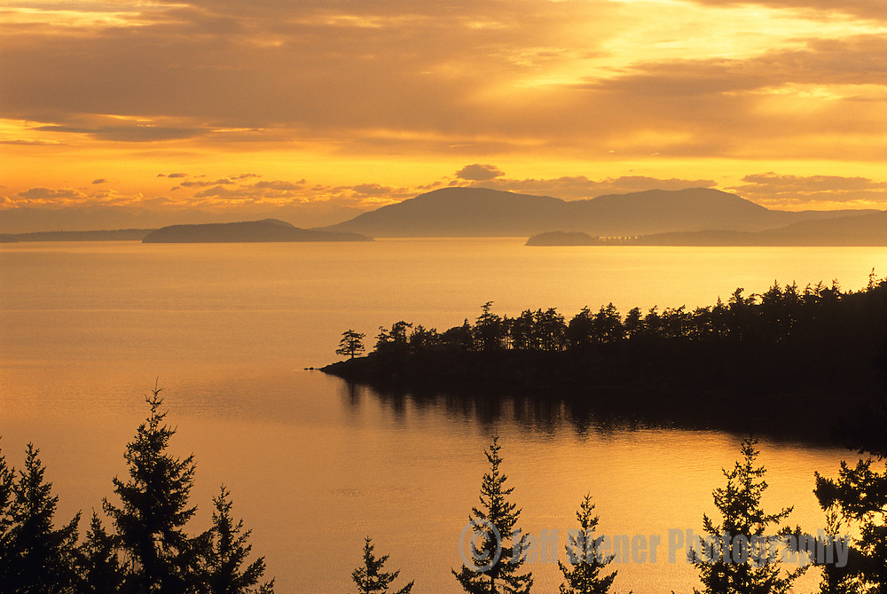 Sunset falls on Chuckanut Bay and the San Juan Islands near Bellingham, Washington.