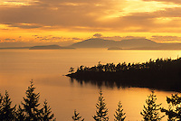Sunset falls on Chuckanut Bay and the San Juan Islands near Bellingham, Washington.