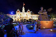 Ho Chi Minh statue in front of City Hall. Policemen on guard.