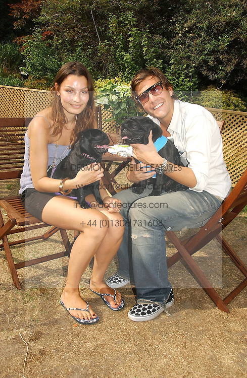 OSCAR HUMPHRIES and SARA PHILIPPIDIS with his dogs Gus and Taz at the Macmillan Cancer Support Dog Day held in the gardens of the Royal Hospital, Chelsea, London on 4th July 2006.<br />