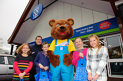 Parklands Food Store, Boultham Park Road, Lincoln: The Lincolnshire Co-operative's new mascot Cooper the Bear meets some of the youngsters who named him for the first time.  From left, Cameron Willis (nine), Kaye Robinson (Lincolnshire Co-operative Membership and Community), Ben Banks (nine), Cooper the Bear, Alice Olsen-Smith (10) and Emily Quill (10).<br /> <br /> Youngsters have named the Lincolnshire Co-operative mascot, Cooper the bear, who they met for the first time on the weekend during the Co-op's Christmas Event Day.<br /> <br /> Date: November 28, 2015<br /> Picture: Chris Vaughan/Chris Vaughan Photography