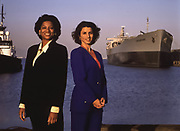 Black woman and white woman leaders at pier