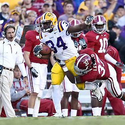 November 6, 2010; Baton Rouge, LA, USA; Alabama Crimson Tide cornerback Robert Lester (37) tackles LSU Tigers running back Stevan Ridley (34) during the second half at Tiger Stadium. LSU defeated Alabama 24-21.  Mandatory Credit: Derick E. Hingle