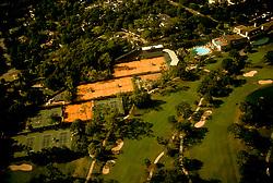 Stock photo of an aerial view of golf course and tennis courts.
