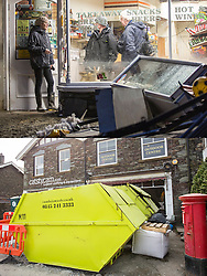 © Licensed to London News Pictures. 11/05/2016. Glenridding UK. FIVE MONTH COMPARISON OF FLOODED VILLAGE OF GLENRIDDING. Top picture taken 10/12/2015 shows the Glenridding village food store after storm Desmond flooded the village in December. Bottom picture taken 10/05/2016 shows the now closed Glenridding village food store in Glenridding five months after storm Desmond. The diggers are still in the village of Glenridding five months after storm Desmond hit the area & flooded the village three times last December. Residents of the village have become frustrated at the Environment Agency after it took almost four months for the agency to start work on new flood defences leaving the village looking like a building site during the normally busy tourist period essential to get the area back on it's feet. Photo credit: Andrew McCaren/LNP
