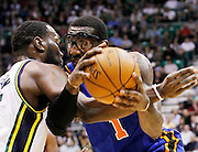 New York Knicks forward Amare Stoudemire, right, is fouled by Utah Jazz center Al Jefferson, left, during the first half of an NBA basketball game in Salt Lake City, Wednesday Jan. 12, 2011. (AP Photo/Colin E Braley)