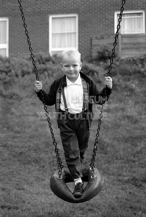 Boy On Swing, High Wycombe, UK, 1980s.