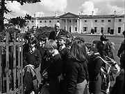 President Hillery Meets Schoolchildren at The Arás.(R59)..1987..15.06.1987..06.15.1987..15th June 1987..As part of an educational tour pupils from Scoil Barra, Ballincollig, Cork were treated to a tour of Arás on Uachtaráin. The pupils were very lucky as the president himself,Dr Hillery, pointed out the highlights of the Arás. With the party was the class teacher Ms Orla Murphy...President Hillery with his Aide deCamp shows the pupils a commemorative tree planted in the garden .of Arás on Uachtaráin.