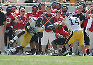 01 SEPTEMBER 2007: Iowa cornerback Charles Godfrey (13) intercepts a pass intended for Northern Illinois wide receiver Evans Adonis (13) as Iowa free safety Devan Moylan (14) looks on in Iowa's 16-3 win over Northern Illinois at Soldiers Field in Chicago, Illinois on September 1, 2007.