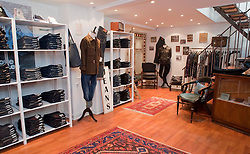 Picture shows Copenhagen premium denim shop A Small Jean Company. Owned and run by Carsten Lund Nygaard Frederiksen the shop opened in August 2013 and specialises in selvedge denim and other assorted high end brands, including Lewis Leathers. http://asmalljeanscompany.com<br /> <br /> See www.new-utility.co.uk<br /> <br /> Credit should read: Picture by Mark Larner<br /> NO UNAUTHORISED USAGE