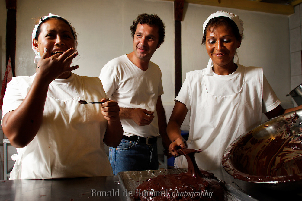 Harm van Oudenhoven, with two of his employees, experimenting with a new type of chocolate.