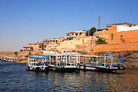 boats and village on the shore of the nasser lake in aswan egypt