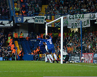 Photo: Leigh Quinnell.<br /> Chelsea v Real Betis. UEFA Champions League.<br /> 19/10/2005. Chelseas Ricardo Carvalho forces the ball past Betis goalkeeper Antonio Doblas.