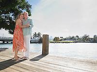 Couple embracing standing on pier portrait