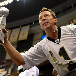 September 9, 2010; New Orleans, LA, USA; A New Orleans Saints fan holds up a mock Lombardi Trophy during warm ups prior to kickoff of the NFL Kickoff season opener at the Louisiana Superdome. The New Orleans Saints defeated the Minnesota Vikings 14-9.  Mandatory Credit: Derick E. Hingle