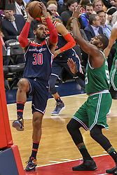 April 10, 2018 - Washington, DC, U.S. - WASHINGTON, DC - APRIL 10:  Washington Wizards forward Mike Scott (30) in action against Boston Celtics center Greg Monroe (55) on April 10, 2018 at the Capital One Arena in Washington, D.C.  The Washington Wizards defeated the Boston Celtics, 113-101.  (Photo by Icon Sportswire) (Credit Image: © Icon Sportswire/Icon SMI via ZUMA Press)