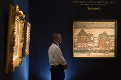 © licensed to London News Pictures. London, UK. 22/06/2011. 'House With  Laundry (Suberb II)' by Egon Schiele (right) which sold for over £24 million at Sotheby's  auction of Impressionist and Modern art this evening (22/06/2011). Please see special instructions for usage rates. Photo credit should read Ben Cawthra/LNP